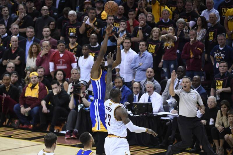 Golden State Warriors forward Kevin Durant (35) shoots the basketball against Cleveland Cavaliers forward LeBron James (23) during the fourth quarter in game three of the 2017 NBA Finals at Quicke ...