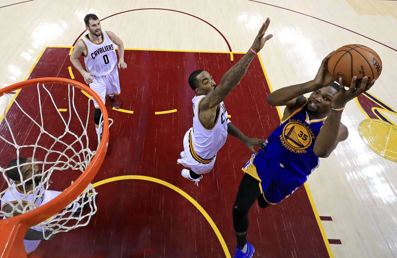Golden State Warriors forward Kevin Durant (35) shoots the ball against Cleveland Cavaliers guard JR Smith (5) in game three of the 2017 NBA Finals at Quicken Loans Arena. (Ronald Martinez/Pool Ph ...