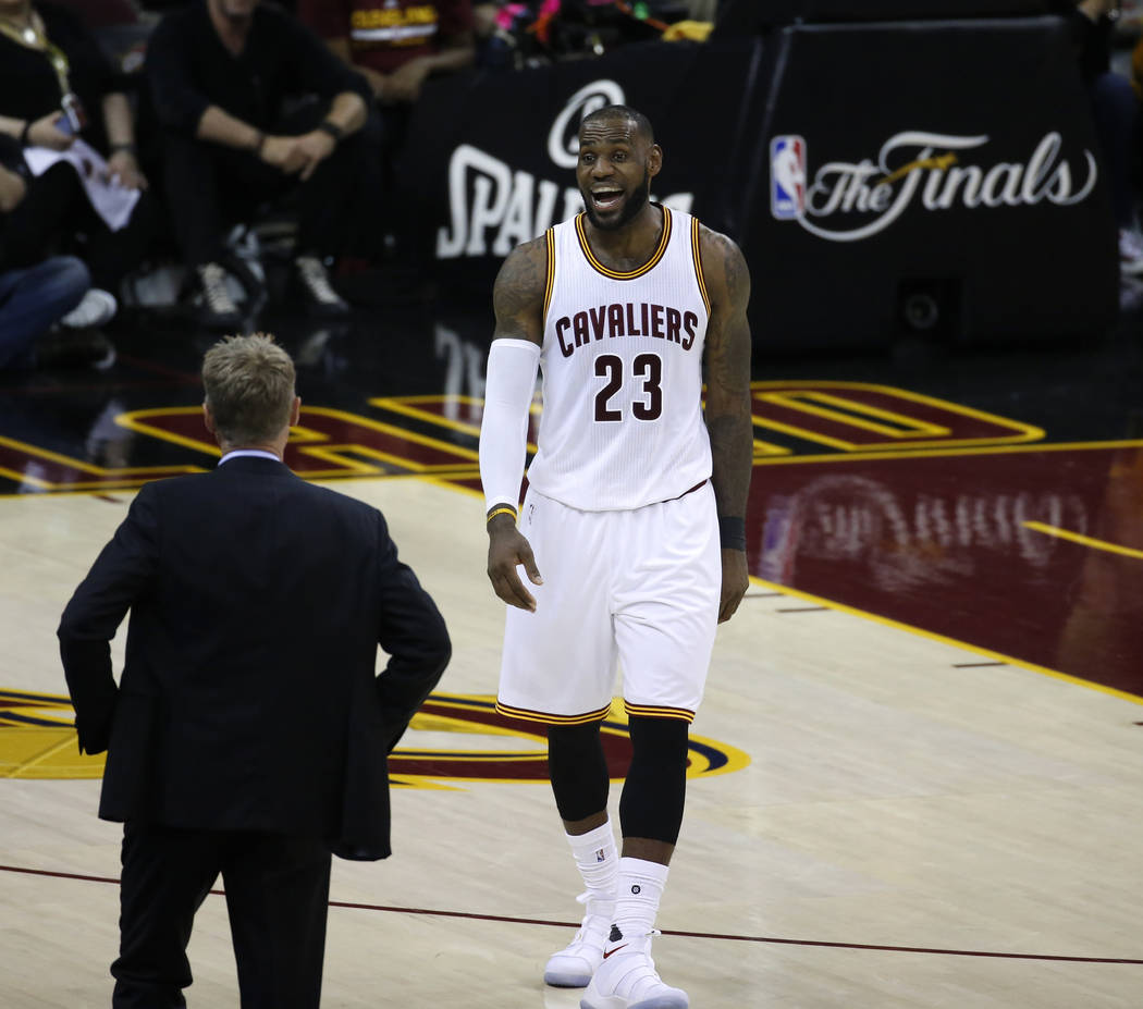 Cleveland Cavaliers forward LeBron James (23) talks to Golden State Warriors coach Steve Kerr during the first half of Game 3 of basketball's NBA Finals in Cleveland, Wednesday, June 7, 2017. (AP  ...