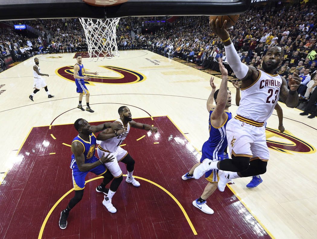 Cleveland Cavaliers forward LeBron James (23) drives against the Golden State Warriors during the first half of Game 3 of basketball's NBA Finals in Cleveland, Wednesday, June 7, 2017. (Kyle Terad ...