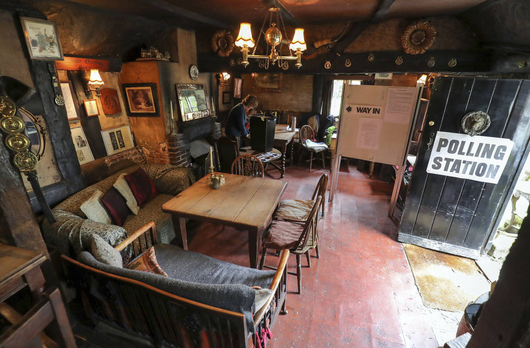 A view inside of a polling station at the White Horse Inn in Priors Dean, Hampshire, England also known as the 'Pub with no name' Thursday June 8, 2017. Polls are open from 7 a.m. to 10 p.m. (0600 ...