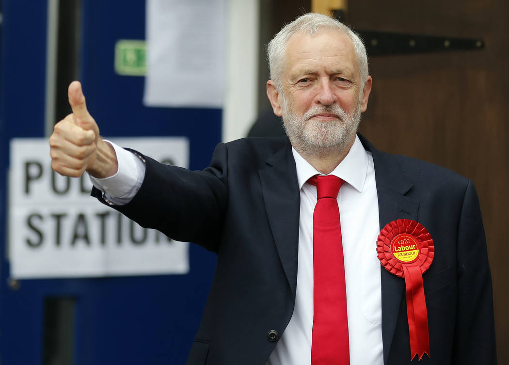 Britain's Labour party leader Jeremy Corbyn gestures as he arrives to vote in the general election at a polling station in London, Thursday, June 8, 2017. (AP Photo/Frank Augstein)