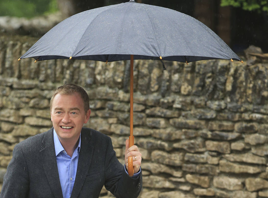 Britain's Liberal Democrats leader Tim Farron arrives to cast his vote in the General Election at a polling station at Stonecross Manor Hotel in Kendal, England Thursday, June 8, 2017. Polling sta ...