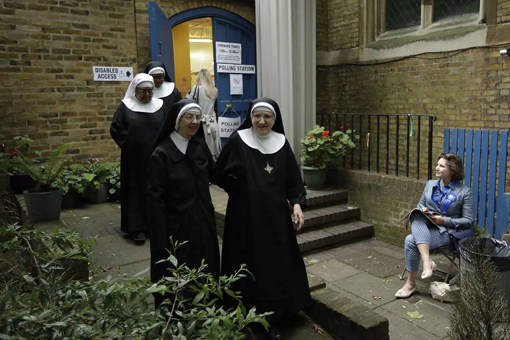 Benedictine nuns from Tyburn Convent leave after voting in Britain's general election at a polling station in St John's Parish Hall, London, Thursday, June 8, 2017.  (Matt Dunham/AP)