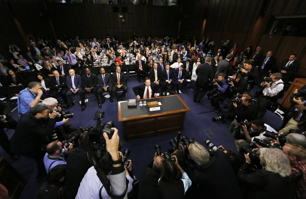 Former FBI Director James Comey is seated prior to testifying before a Senate Intelligence Committee hearing on Russia's alleged interference in the 2016 U.S. presidential election on Capitol Hill ...