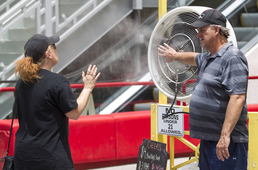 Passerbys cool off in front of a misting fan on the Las Vegas Strip on Thursday, June 8, 2017. Richard Brian Las Vegas Review-Journal @vegasphotograph