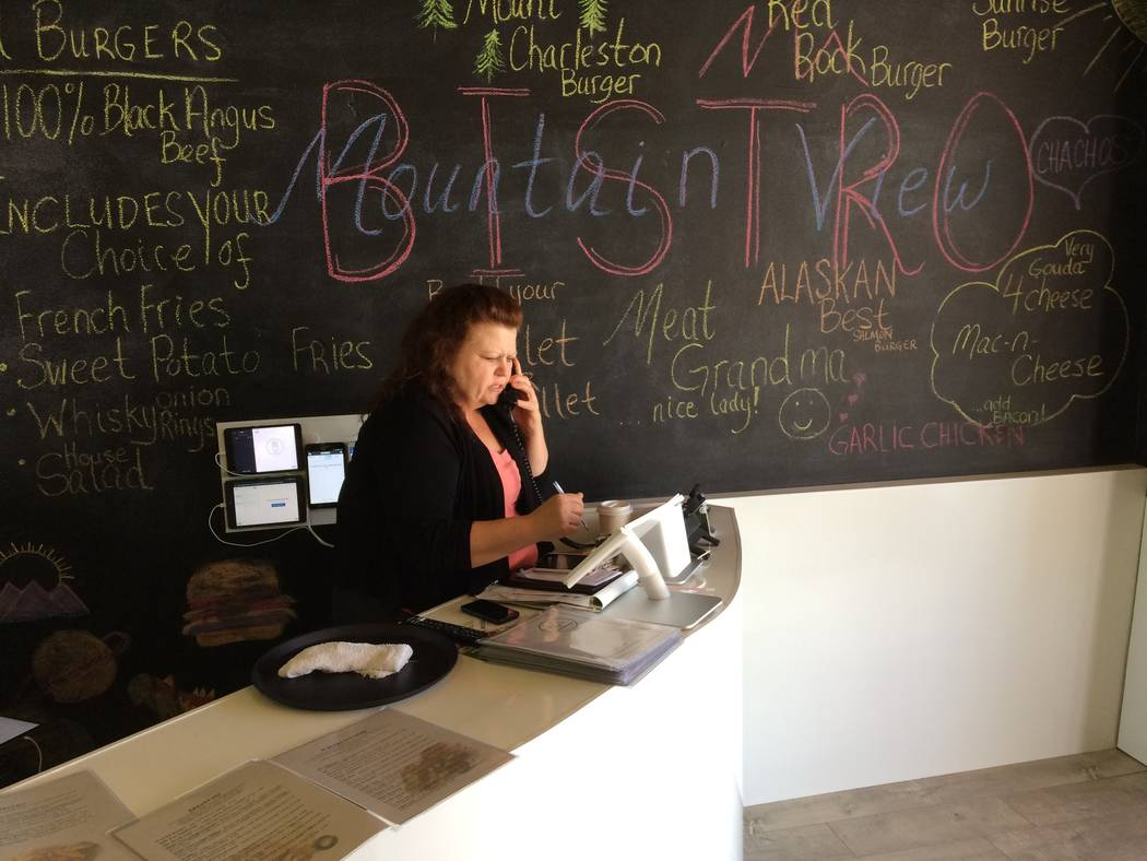 Lisa Knight, manager/owner, takes a phone order May 26, 2017 at Mountain View Bistro, which borrowed its name from nearby MountainView Hospital. The eatery is gaining a popular following. (Jan Hog ...