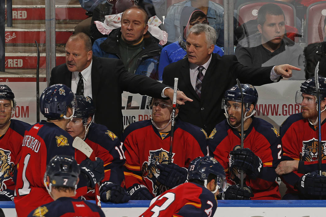 Florida Panthers head coach Gerald Gallant, top left, and assistant coach Mike Kelly, top right, direct their players during a timeout against the Ottawa Senators during the third period of an NHL ...