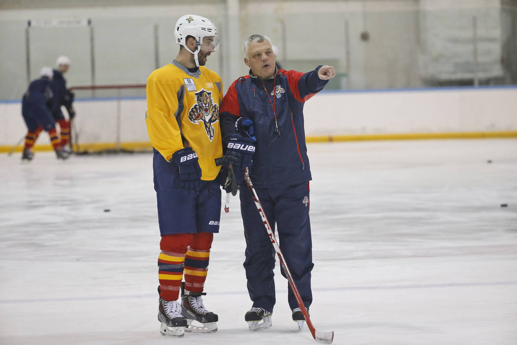 Florida Panthers right wing Teddy Purcell, left, talks with assistant coach Mike Kelly during a practice session, Tuesday, April 12, 2016, at the Panthers' practice facility in Coral Springs, Fla. ...