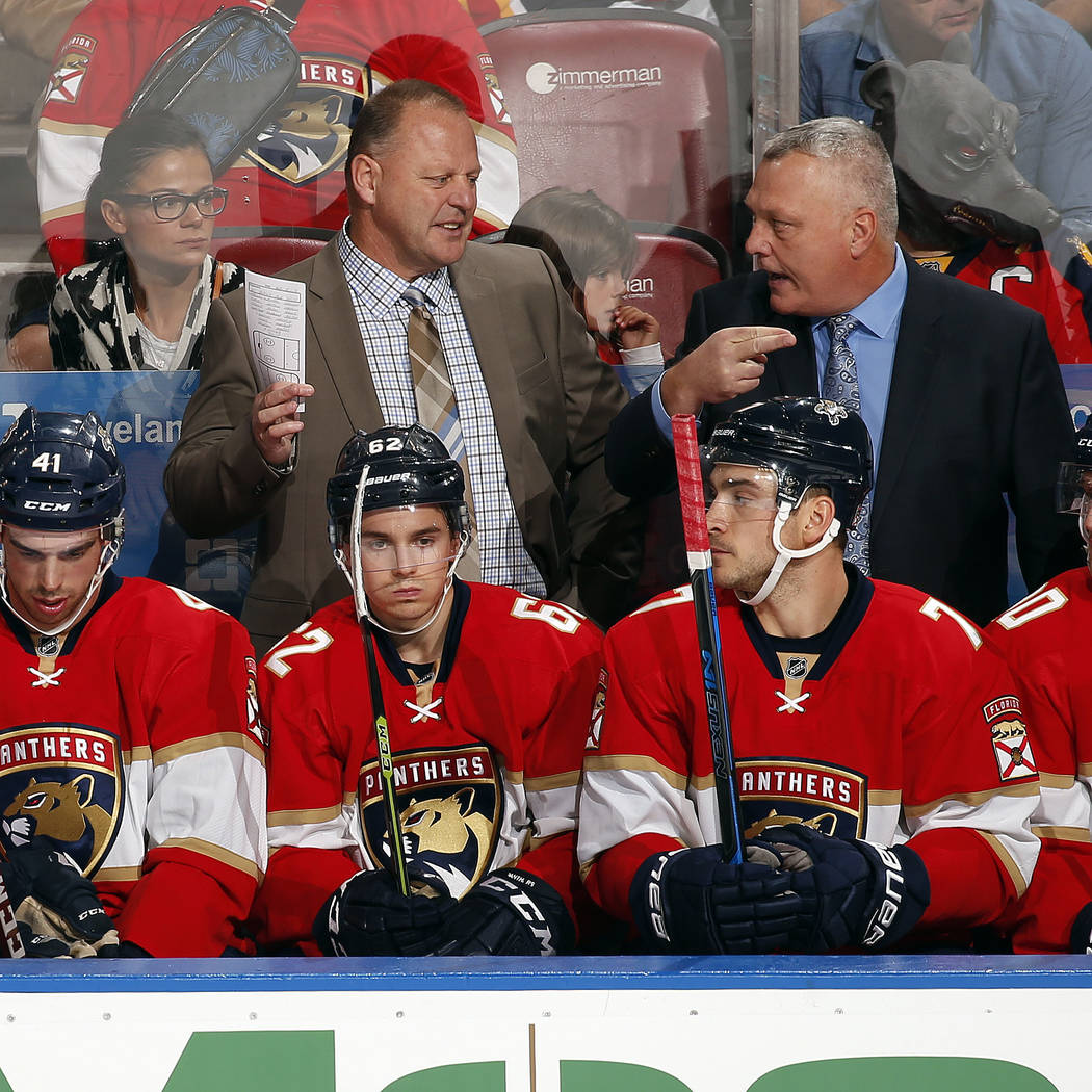 Head Coach of the Florida Panthers Gerard Gallant chats with Assistant Coach Mike Kelly during a break in the action against the Detroit Red Wings at the BB&T Center on October 15, 2016 in Sun ...