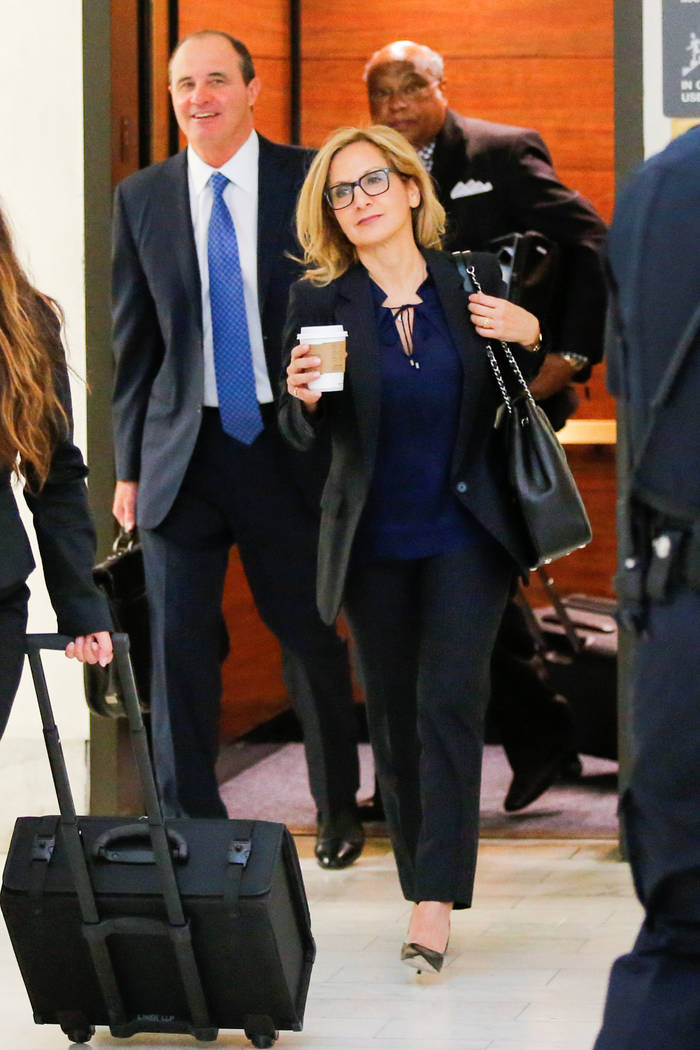 Bill Cosby's attorney Angela Agrusa (C) and defense attorney Brian McMonagle (L) arrive on the fourth day of Cosby's sexual assault trial at the Montgomery County Courthouse in Norristown, Pennsyl ...