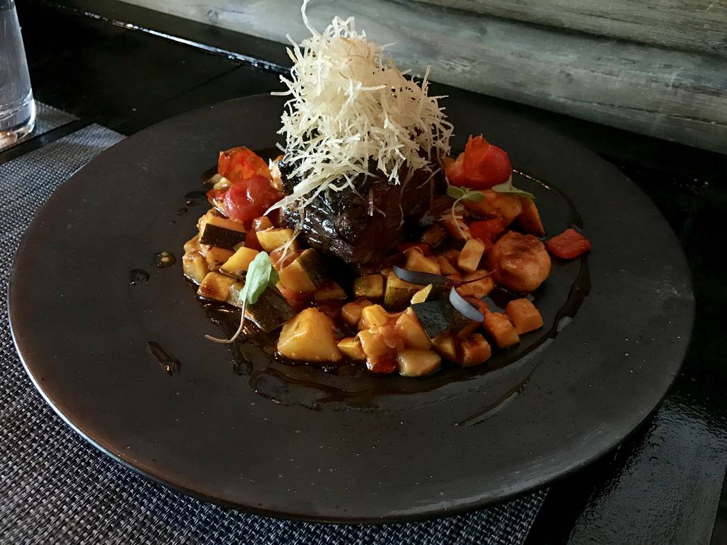 The Black Sheep's braised short rib ($19) is laced with yucca threads and nestled in several pieces of yucca gnocchi and summer squash ratatouille.