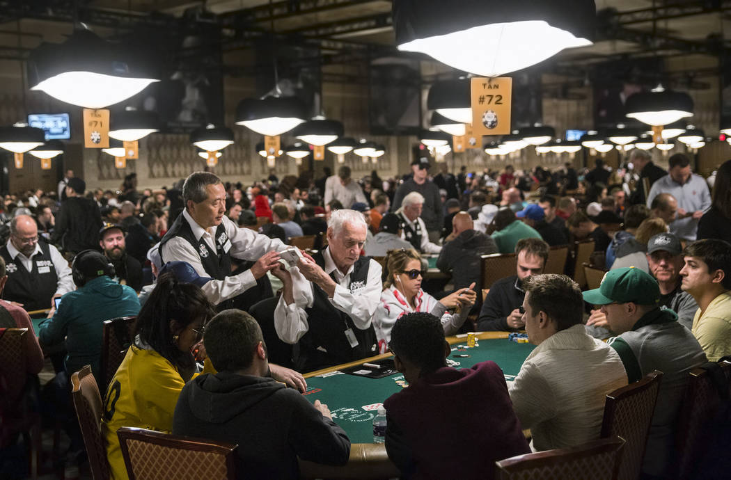 Alex Christoff, middle, deals a hand at the World Series of Poker on Saturday, June 7, 2017, at the Rio hotel-casino, in Las Vegas. Christoff has worked at the WSOP for over 30 years. Benjamin Hag ...