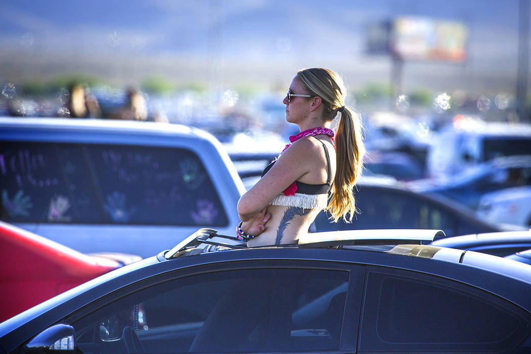 A fan waits for traffic to move in the Las Vegas Speedway parking lot after the Electric Daisy Carnival ended on Monday, June 22, 2015. An estimated crowd of 140,000 people attended the three-day  ...