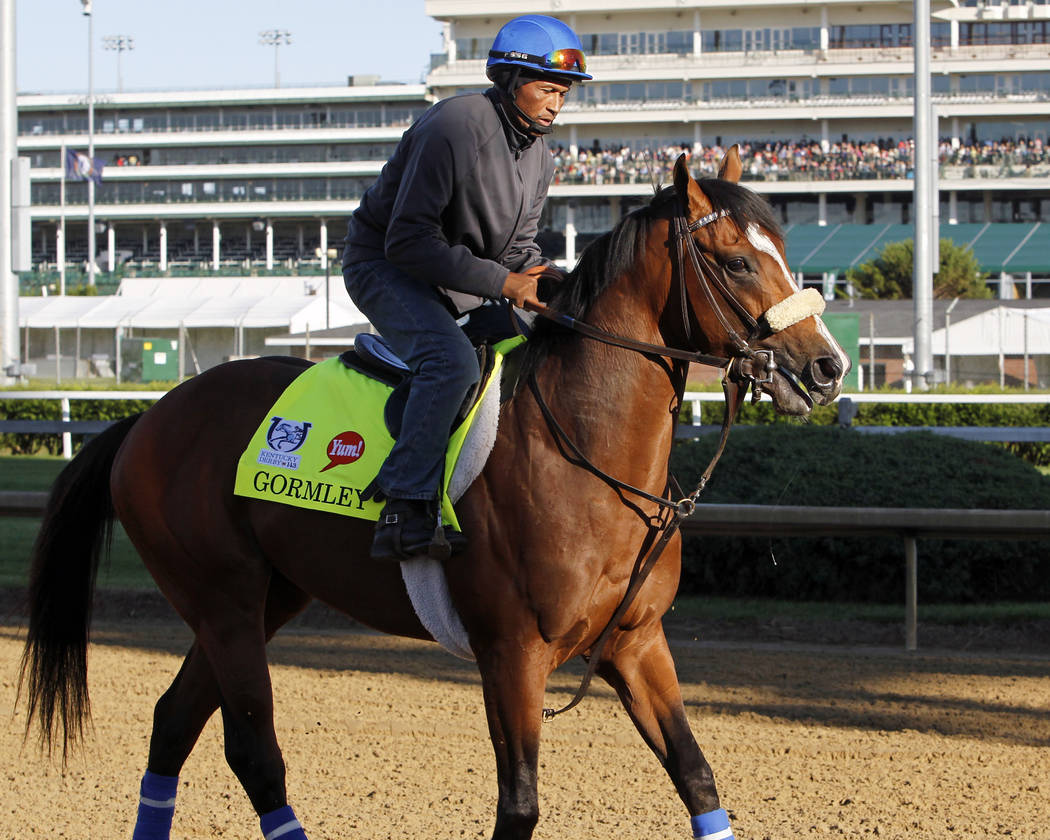 Kentucky Derby hopeful Gormley, with exercise rider Francisco Alvarado aboard, checks out the race track at Churchill Downs in Louisville, Ky., Tuesday, May 2, 2017. The colt made his first trip t ...
