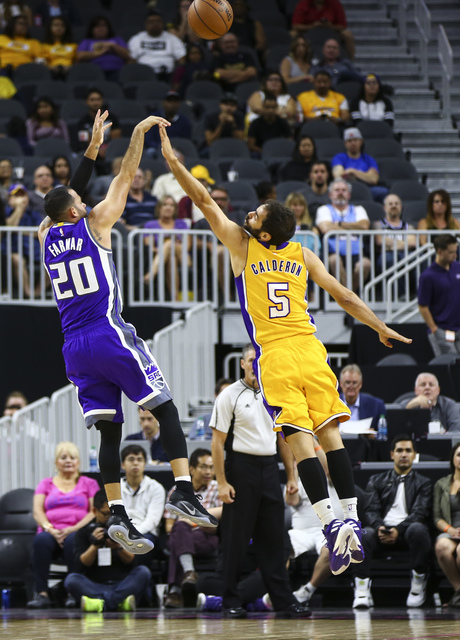 Sacramento Kings guard Jordan Farmar (20) goes up for a shot over Los Angeles Lakers guard Jose Calderon (5) during a preseason basketball game at the T-Mobile Arena in Las Vegas on Thursday, Oct. ...
