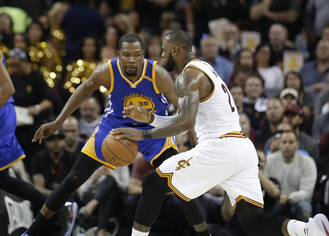 Golden State Warriors forward Kevin Durant (35) guards Cleveland Cavaliers forward LeBron James (23) during the second half of Game 3 of basketball's NBA Finals in Cleveland, Wednesday, June 7, 20 ...