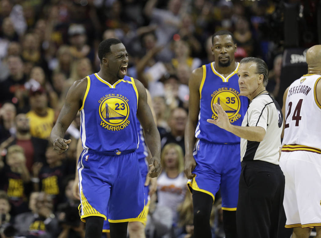 Golden State Warriors forward Draymond Green (23) argues a call against the Cleveland Cavaliers during the second half of Game 3 of basketball's NBA Finals in Cleveland, Wednesday, June 7, 2017. ( ...