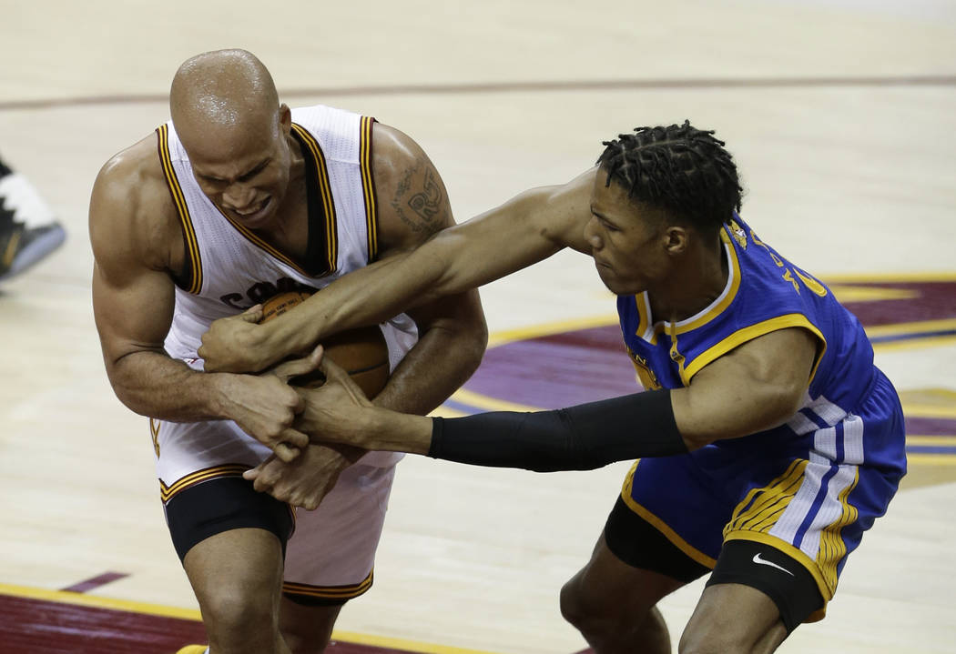 Cleveland Cavaliers forward Richard Jefferson (24) and Golden State Warriors guard Patrick McCaw (0) battle for a loose ball during the second half of Game 3 of basketball's NBA Finals in Clevelan ...