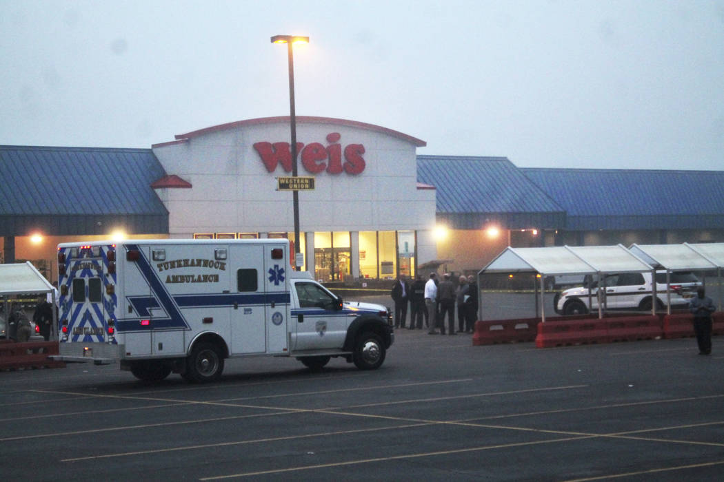 An ambulance waits outside of a Weis Market, the scene of a shooting in Tunkhannock, Pa., on Thursday, June 8, 2017.  State police say four people are dead in a murder-suicide in the Pennsylvania  ...