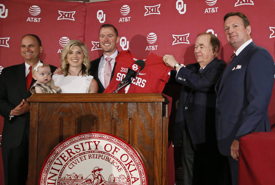 Lincoln Riley, center, is announced as the new head football coach at Oklahoma during a news conference in Norman, Okla., Wednesday, June 7, 2017. From left are Joe Castiglione, Oklahoma athletic  ...