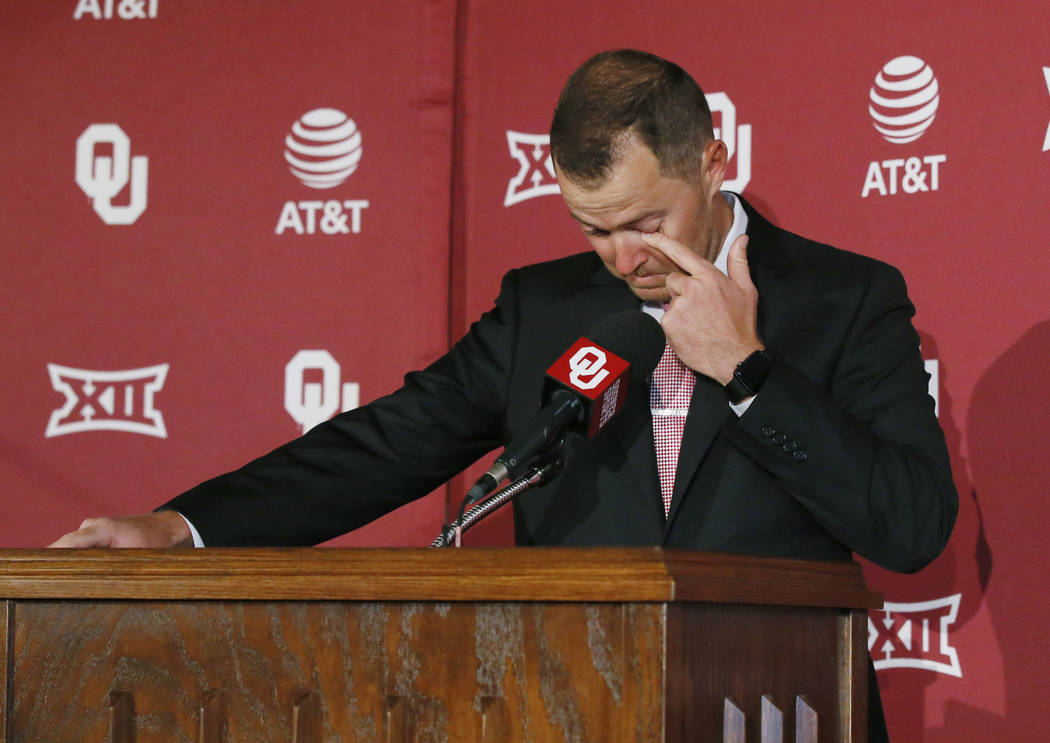 Lincoln Riley gets emotional during a news conference at which the retirement of Oklahoma football coach Bob Stoops was announced in Norman, Okla., Wednesday, June 7, 2017. Riley was named to succ ...