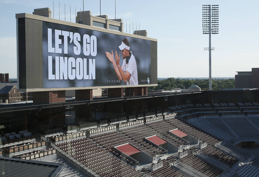 "The scoreboard at the Oklahoma football field reads ""Let's Go Lincoln"" following a news conference to announce the retirement of football coach Bob Stoops and the naming of Linco ..."
