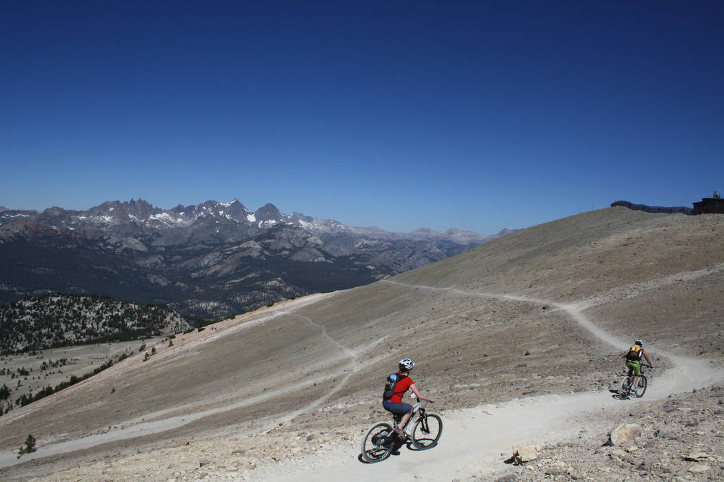 "Mountain bikers at Mammoth Mountain head down from an elevation of 11,053 feet along the switchbacks at the beginning of the ""Off the Top Trail"". (Deborah Wall)"