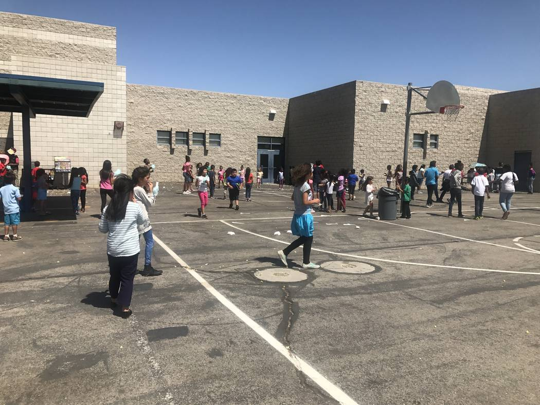 Elizabeth Wilhelm Elementary School students celebrate being the school with the most hours of reading with the Clark County School District's Apple Core (All People Promoting Literacy Efforts and ...