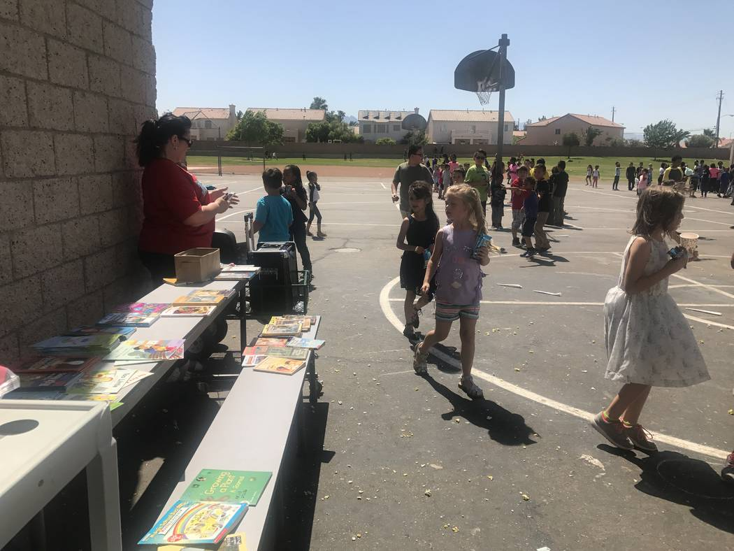 Elizabeth Wilhelm Elementary School students participate in book walk during a school event to celebrate being the school with the most hours of reading with the Clark County School District's App ...