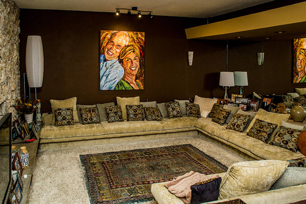 The 1964 home in Marycrest Estates features a suken living room. Local artist Michael Wardel painted the portrait of the couple that hangs in the living room. (Tonya Harvey Real Estate Millions)