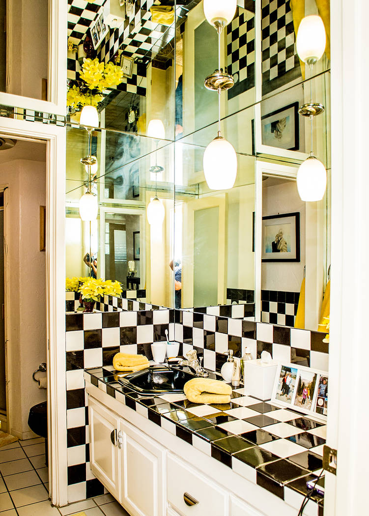 One bath has ablack-and-white tiled backsplash and mirrors on the ceiling and upper walls. (Tonya Harvey Real Estate Millions)