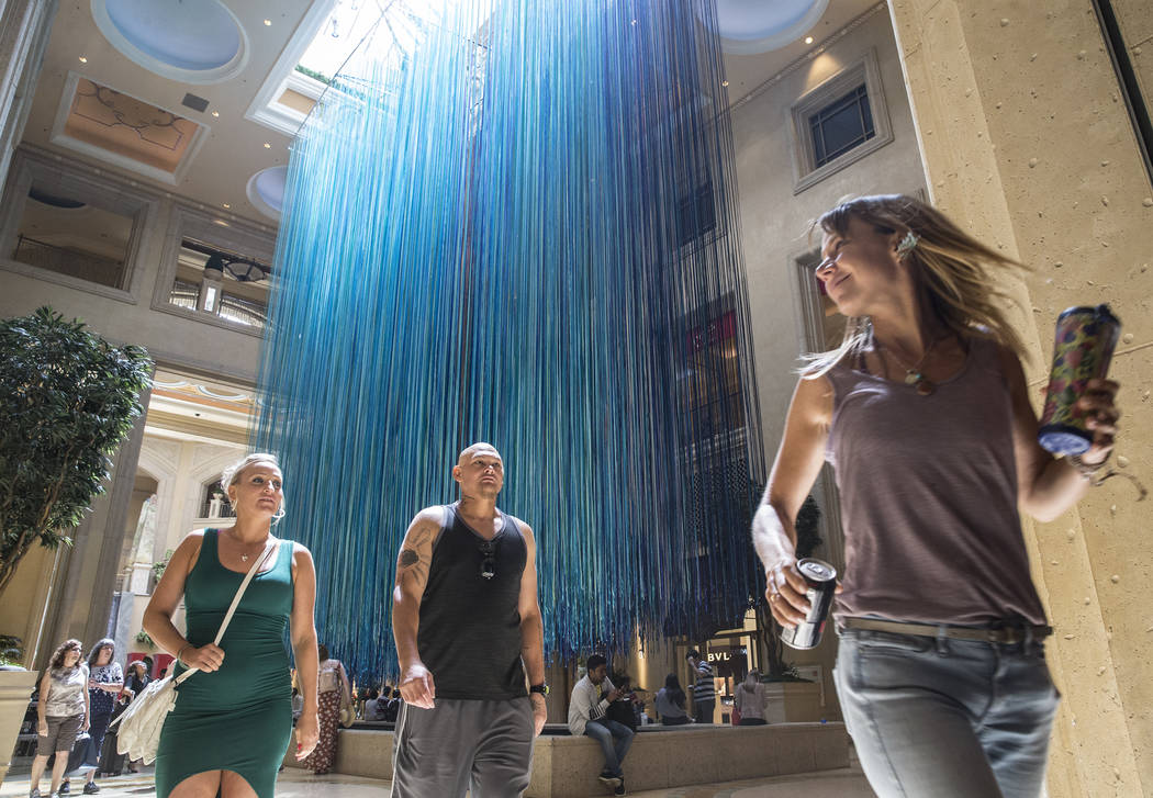 "Shoppers in the waterfall atrium walk by the newly unveiled art installation ""Another Sky"" by artist Anne Patterson on Thursday, June 8, 2017, at The Venetian hotel-casino, in La ..."
