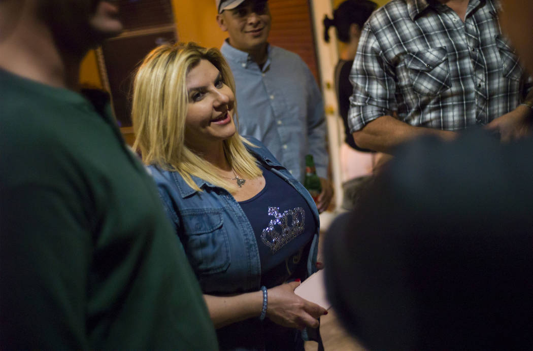 Las Vegas City Council Ward 6 candidate Michele Fiore, a former Nevada Assemblywoman, talks with supporters while waiting for election results come in at her home in Las Vegas on Tuesday, April 4, ...