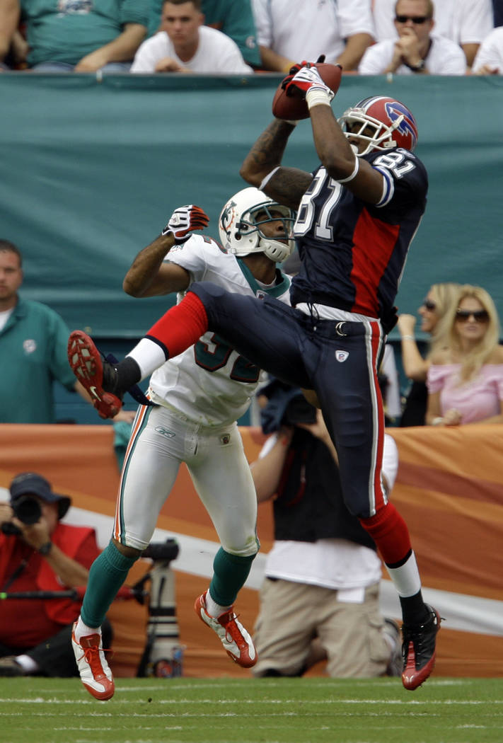 In this Oct. 26, 2008, file photo, Buffalo Bills wide receiver James Hardy, right, catches a pass as he is guarded by Miami Dolphins safety Jason Allen during the first quarter of an NFL football  ...