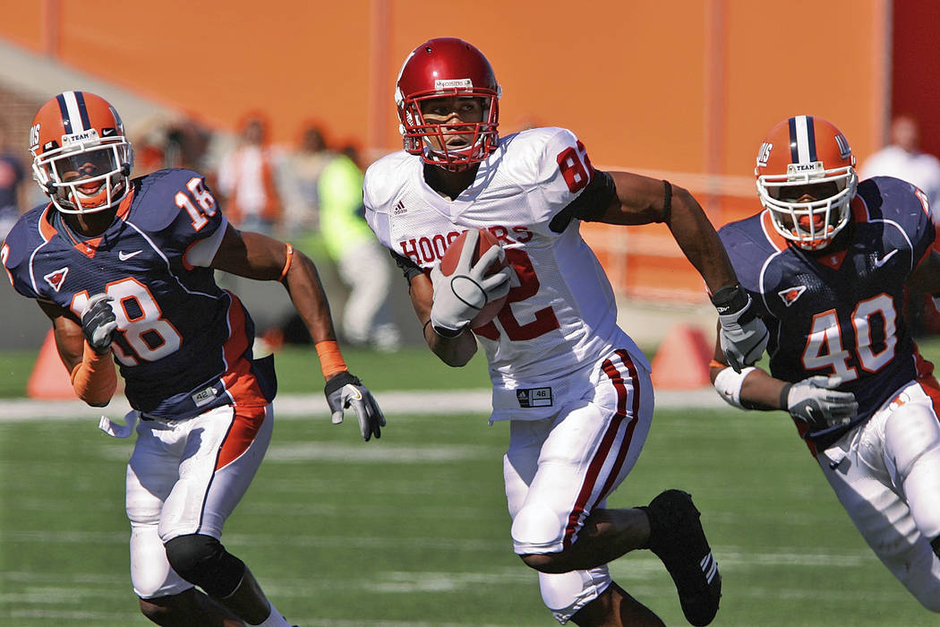 In this Oct. 7, 2006, file photo, Indiana's James Hardy (82) breaks free from Illinois defenders Alan Ball, left, and Antonio Steele, right, during a football game in Champaign, Ill. Authorities s ...