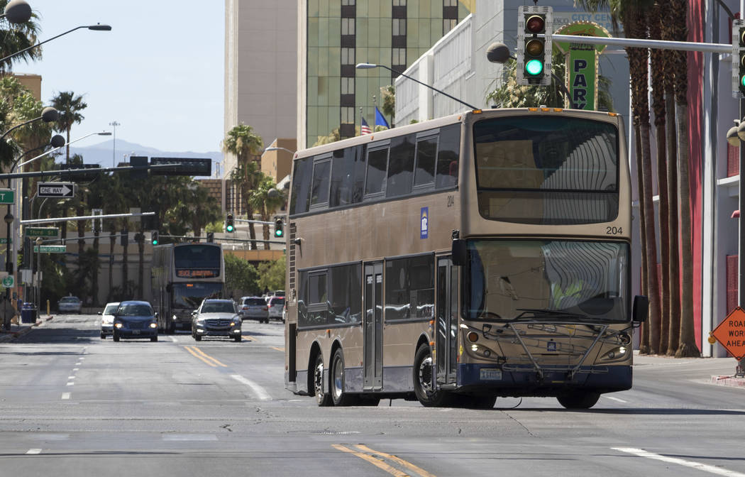 A Regional Transportation Commission bus turns onto North Las Vegas Boulevard from East Carson Avenue in downtown Las Vegas on Friday, June 9, 2017, where a light rail line will be built connectin ...