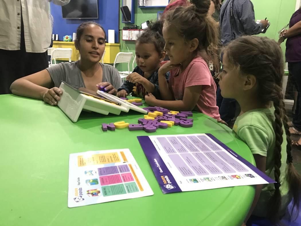 Veronica Martinez and daughters Alexandria, 3, and 5-year-old twins Isabelle and Crystal demonstrate Square  Panda's multi-sensory phonics learning system for early literacy skills June 6 at Shade ...