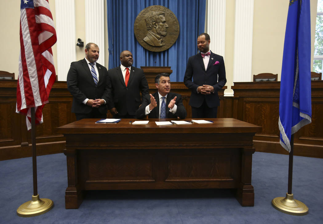 Gov. Brian Sandoval, third from left, speaks before signing a group of bills while flanked by, from left, Assembly Minority Floor Leader Paul Anderson, R-Las Vegas, Assembly Speaker Jason Frierson ...