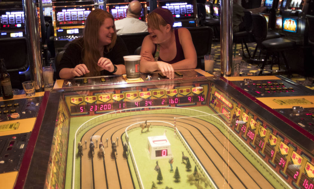 Sisters Kiera Richardson, left, Emily Richardson of St. George, Utah, play the Sigma Derby horse race game at the D Las Vegas in downtown Las Vegas on Friday, June 9, 2017. Richard Brian Las Vegas ...