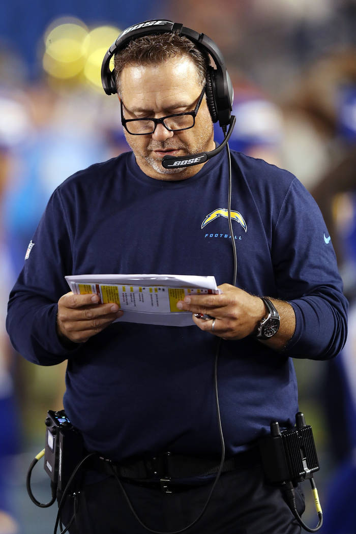 Denver Broncos defensive coordinator John Pagano checks out his play chart on the sideline during the 2016 NFL week 6 regular season football game against the Denver Broncos on Thursday, Oct. 13,  ...