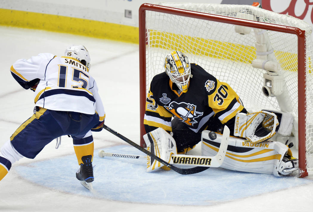 Pittsburgh Penguins goalie Matt Murray (30) blocks a shot against Nashville Predators center Craig Smith (15) during the third period in game five of the 2017 Stanley Cup Final at PPG PAINTS Arena ...