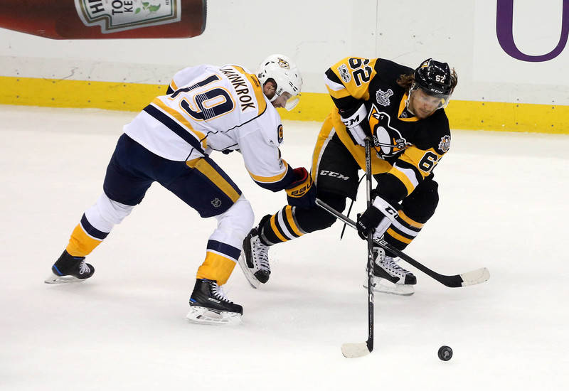 Nashville Predators center Calle Jarnkrok (19) plays for the puck against Pittsburgh Penguins left wing Carl Hagelin (62) during the second period in game five of the 2017 Stanley Cup Final at PPG ...