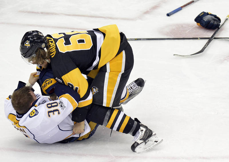 Pittsburgh Penguins left wing Carl Hagelin (62) fights Nashville Predators right wing Viktor Arvidsson (38) during the third period in game five of the 2017 Stanley Cup Final at PPG PAINTS Arena.  ...