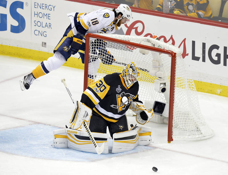 Pittsburgh Penguins goalie Matt Murray (30) blocks a shot against Nashville Predators left wing James Neal (18) during the third period in game five of the 2017 Stanley Cup Final at PPG PAINTS Are ...