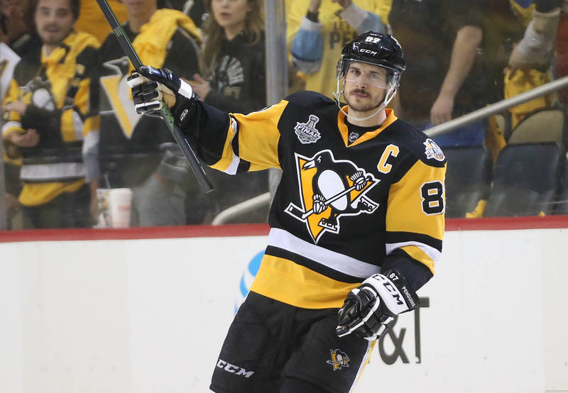 Pittsburgh Penguins center Sidney Crosby (87) celebrates the victory against the Nashville Predators following the third period in game five of the 2017 Stanley Cup Final at PPG PAINTS Arena. (Cha ...