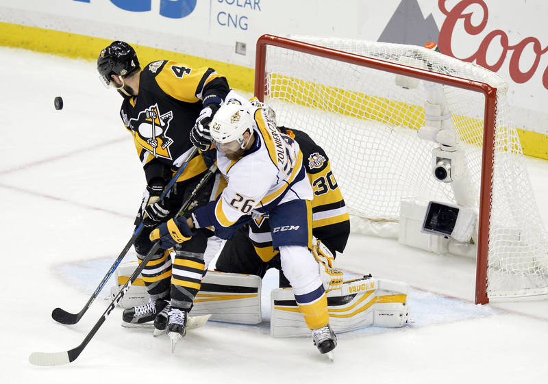 Pittsburgh Penguins defenseman Justin Schultz (4) helps goalie Matt Murray (30) defend the goal on a shot as Nashville Predators right wing Harry Zolnierczyk (26) is in position for the rebound du ...