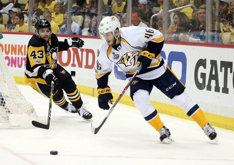 Nashville Predators left wing Pontus Aberg (46) moves the puck against Pittsburgh Penguins left wing Conor Sheary (43) during the third period in game five of the 2017 Stanley Cup Final at PPG PAI ...