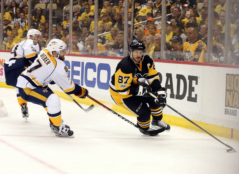 Pittsburgh Penguins center Sidney Crosby (87) moves the puck against Nashville Predators defenseman Yannick Weber (7) during the third period in game five of the 2017 Stanley Cup Final at PPG PAIN ...