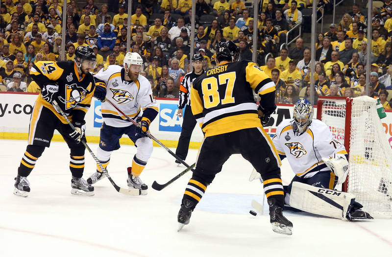 Nashville Predators goalie Juuse Saros (74) defends the goal against Pittsburgh Penguins center Sidney Crosby (87) and left wing Chris Kunitz (14) during the third period in game five of the 2017  ...